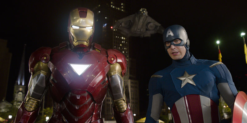 """""""Marvel's The Avengers"""" L to R: Iron Man (Robert Downey Jr.) and Captain America (Chris Evans) with the Quinjet in background Ph: Film Frame © 2011 MVLFFLLC. TM & © 2011 Marvel. All Rights Reserved."""